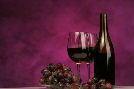 Horizontal of Wine bottle with glasses and grapes on purple background