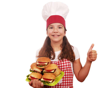 happy little girl cook with hamburgers and thumb up