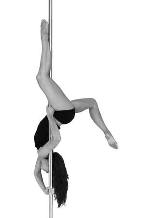 Young woman exercising pole dance fitness, black and white