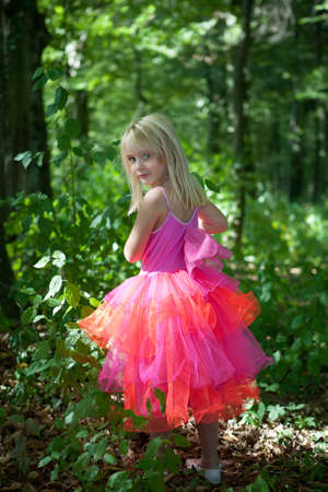 Photo for Little girl in fairy costume in the forest - Royalty Free Image