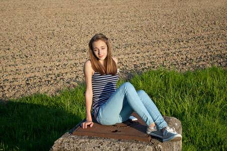 Cute teenage girl in the field