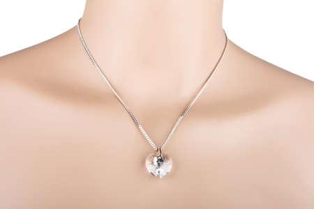 Silver necklace with glass heart pendant on a mannequin