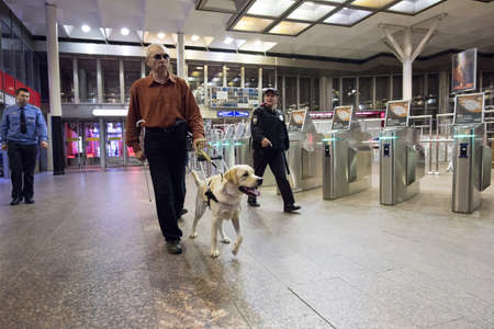 St. Petersburg, Russia - July 17 2015: School to teach the blind to use the subway with dogs allowed. The blind man goes to the subway turnstiles
