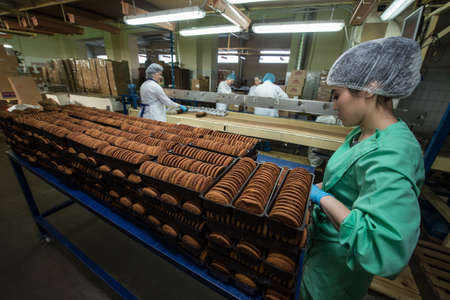 Leningrad region, Russia - February 14, 2017: The production line of confectionery factory Beloved Land. Cookies on the assembly line.