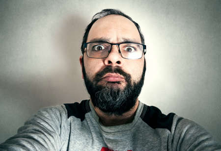 Photo pour Funny man with the beard making expressions - image libre de droit