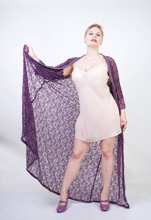 Beautiful woman in purple lace robe on white
