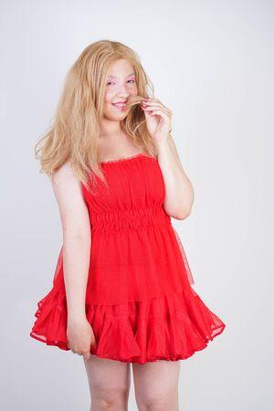 Photo pour Plus size asian fashion model in red dress - image libre de droit