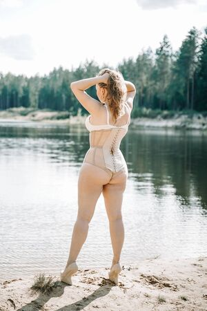 Photo for plus size woman with curvy figure in corset lingerie. caucasian xxl chubby girl wanna swimming. - Royalty Free Image
