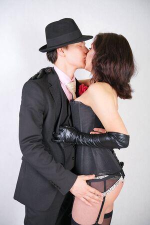 Foto de Happy couple in love hug each other on white studio background - Imagen libre de derechos