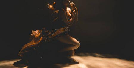 Photo pour young woman swimming alone with fashion fabric underwater incognito - image libre de droit