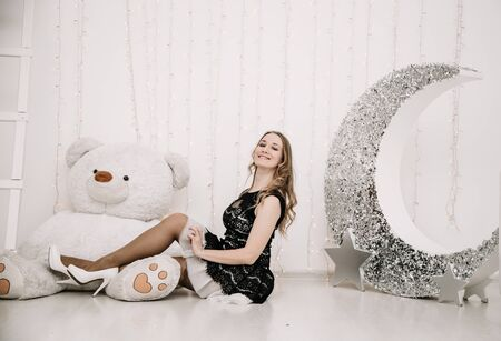 Photo for pretty adult girl with big white teddy bear alone - Royalty Free Image