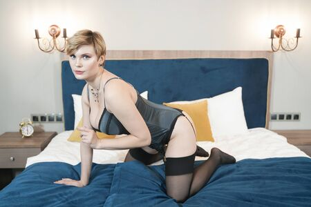 Photo for stylish pin up short hair blonde woman with plus size curvy body posing in fashion underwear in the bedroom alone - Royalty Free Image