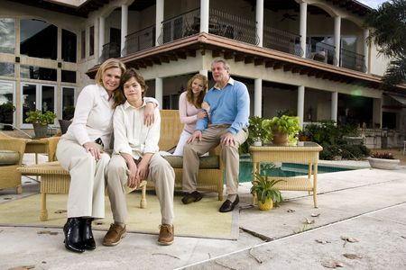 Portrait of family relaxing on patio together