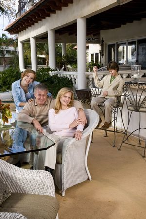 Portrait of carefree family relaxing on outdoor patio