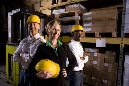 Workers with female boss in storage warehouse