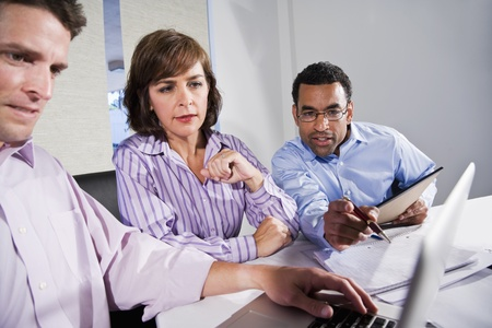 Workplace diversity - multiracial businesspeople working together, main focus on African American man