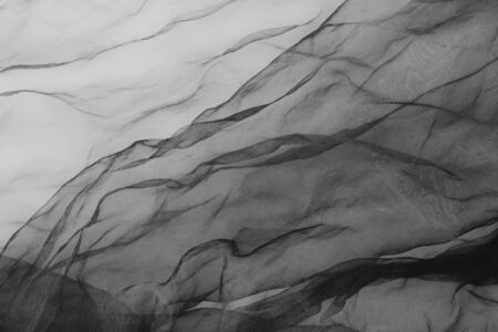 close up of black transparent tulle textile