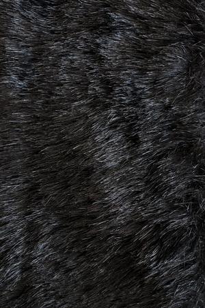 close up of black fur - textile background