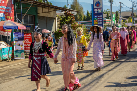 CHIANGMAI, THAILAND - JANUARY 25, 2015: Multi indigenous peoples in parade of 22nd Traditional Skirt Fabric and The Indigenous Product and Culture Festival in Mae Chaem, Chiangmai, Thailand