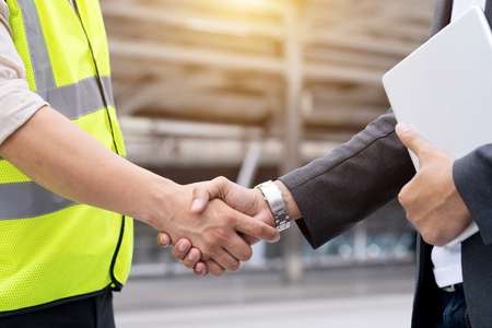 Photo for Engineers shake hands with businessman after success day and celebrate success. - Royalty Free Image