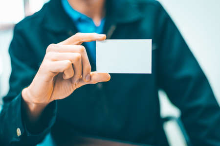 Photo pour Business Man holding white card - image libre de droit