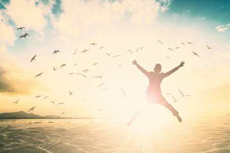Foto de Silhouette of man new generation jump on beautiful background. - Imagen libre de derechos