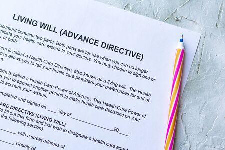 Photo pour Filling Living Will Advance Directive form. Top view - image libre de droit