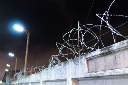 barbed wire on a concrete fence