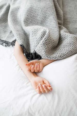 Photo for Bed Hands Protruding Blanket Woman Covered Sleeping Fatigue Loneliness Isolation Introvert Concept - Royalty Free Image