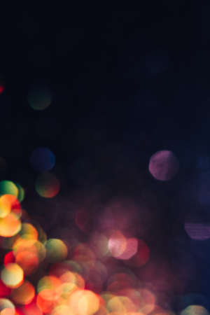 Foto de Abstract blurred light background, colorful lens flare. Glitter in bokeh. Christmas wallpaper decorations concept. New year holiday festive backdrop. Sparkle circle celebrations display. - Imagen libre de derechos
