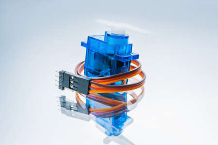 Photo pour microelectronic servomotor on white background. component for control of robots and radio-controlled toys - image libre de droit