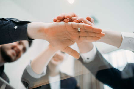 Photo pour teamwork cooperation unity. business people hands together. strength partnership. joined forces to make a prosperous and successful company - image libre de droit