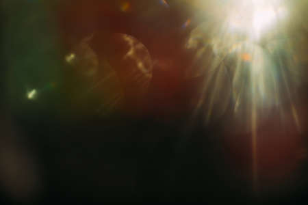 Foto de lens flare. colorful abstract. bokeh light on black background. ray leak - Imagen libre de derechos