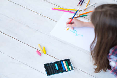 kid creativity and art. girl drawing a flower. child leisure hobby and self expression.