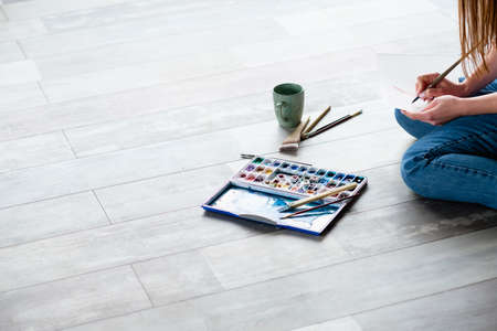 Photo pour creative leisure. painting hobby. artful personality. talented artist drawing sitting on the floor. - image libre de droit
