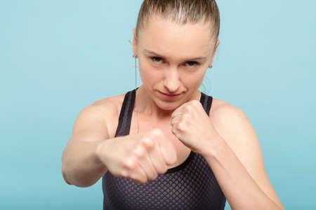 Foto de woman boxing straight blow. self defence strength training and female fighter concept. - Imagen libre de derechos