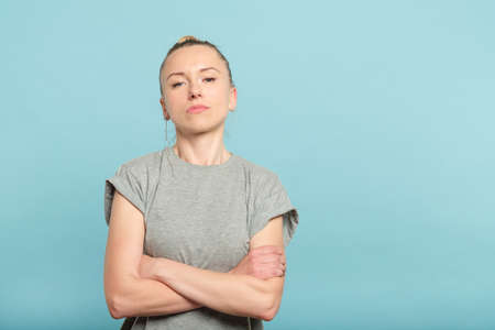 confident serious woman with crossed arms. look of defiance and self assurance.