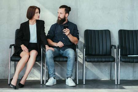 Photo pour woman touching mans knee. work harassment flirt and seduction. - image libre de droit