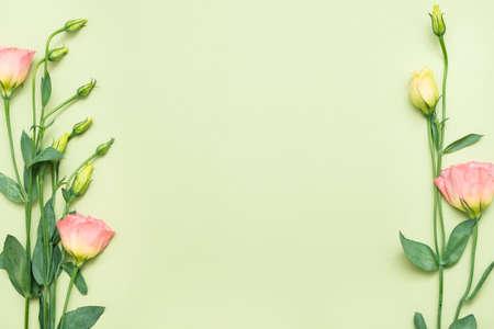 Foto für Pink eustoma flowers border. Floral design concept. Copy space on palegreen background. Flat lay. - Lizenzfreies Bild