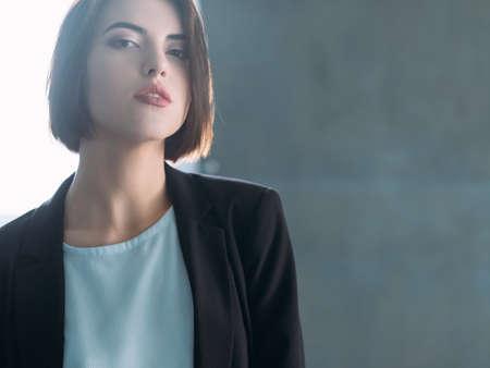 Photo pour Attractive young woman. Arrogant beauty. Confident business lady. Superior and inquisitive look. - image libre de droit