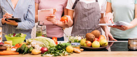 Foto de Cooking classes. Food preparing hobby. Group of women learning healthy eating lifestyle and balanced nutrition. - Imagen libre de derechos