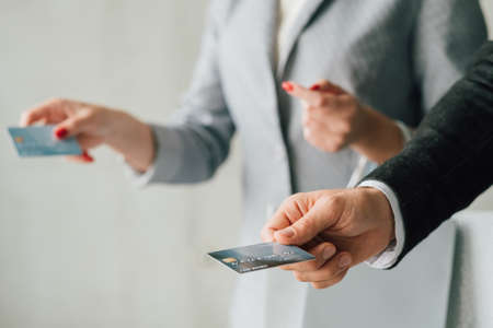 Shopping couple. Easy checkout and electronic payment. Man and woman with credit cards.