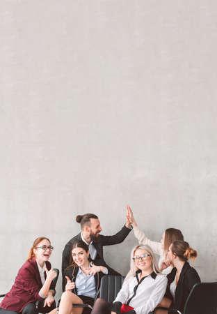 Foto de High five and thumb up. Bussines team celebrating success. Teamwork collaboration and achievements. Happy smiling coworkers. Copy space above - Imagen libre de derechos