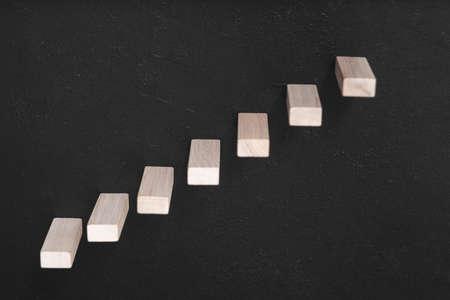 Photo pour Career development. Leadership. Wooden bricks construction representing stairs. Aim, progress and success. Copy space - image libre de droit