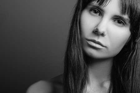 Photo pour Disenchanted beautiful girl. Distrustful facial expression. Black and white closeup portrait of emotional lady. Copy space. - image libre de droit