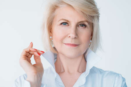 Photo pour Aged self assured female portrait. Confidence and elegance. Stylish senior lady looking at camera. Index finger up. - image libre de droit