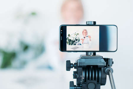 Photo for Woman vlog. Cosmetics and beauty. Female on smartphone screen. Hobby and lifestyle. Video shooting equipment. - Royalty Free Image