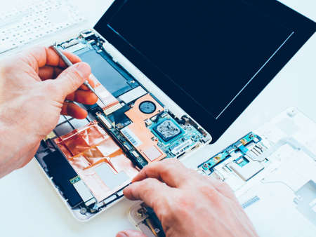 Photo for Laptop repair service. PC hardware upgrade and maintenance. Engineer fixing broken notebook. Computer technology. - Royalty Free Image