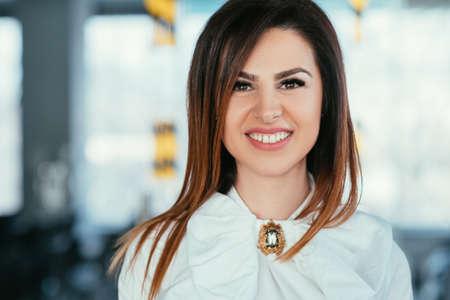Photo pour Smiling young business lady portrait. Beautiful successful female looking at camera. Prosperity contentment delight. - image libre de droit