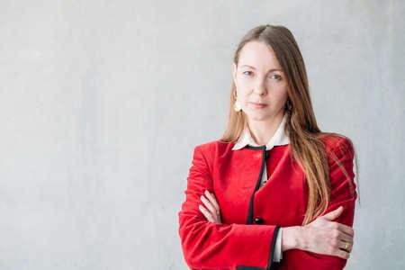 Photo pour Middle aged woman. Arms folded. Confident business female serious facial expression. Classy smart corporate ceo boss. - image libre de droit